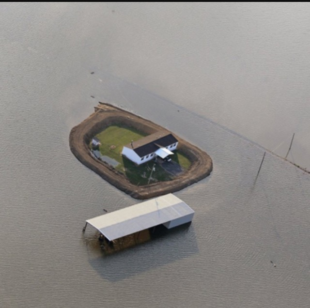 levee fully surrounded home